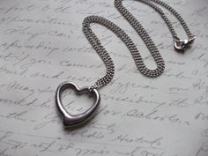 Simple and minimalist stainless steel floating heart charm with swarovski clear crystal on a tarnish proof hypoallergenic stainless steel chain. Chain is 18 in. long (adjustable on demand) Heart charm is 23 x Style Simple, Stainless Steel Chain, Pendant Necklace, Etsy, Heart, Boutique, Beautiful, Jewelry, Necklace Ideas
