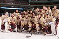 BC poses for a team picture. - The Boston College Eagles defeated the University of Notre Dame Fighting Irish 4-3 in the second half of the Hockey East Frozen Fenway's first Saturday on January 4, 2014 at Fenway Park in Boston, Massachusetts.