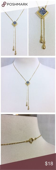 """Blue Mosaic Inlay GoldTone Lariat Necklace Blue Mosaic Inlay GoldTone Lariat Necklace --- Beautiful functional preloved lariat necklace --- Pendant slides up & down chains ---  2 chains are finished w/ 2 teardrop GoldTone finials  --- 12.5"""" drop --- 24"""" length --- Necklace is unmarked & I am unsure of the metal content or type of stone --- The stone in the diamond shaped pendant is absolutely beautiful --- Mosaic w/ tens of blue stones of different sizes, colors, shapes, & opacities…"""