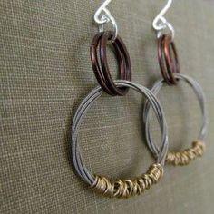 String Hoop Dangle Earrings // Salvaged Guitar String Mixed Metal Earrings // Recycled Guitar String Wire Wrapped Earrings Cool take on a hoop earrings. Like the mixed metal jewelry too.Cool take on a hoop earrings. Like the mixed metal jewelry too. Sea Glass Jewelry, Wire Jewelry, Jewelery, Handmade Jewelry, Silver Jewelry, Silver Rings, Dainty Jewelry, Modern Jewelry, Indian Jewelry