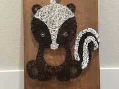Check out this item in my Etsy shop https://www.etsy.com/listing/605661867/string-art-woodland-skunk