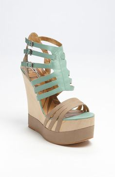 """Matiko 'Haruka' Sandal   A sculptural, wooden wedge creates clean, organic height beneath a strappy sandal in lightly textured leather.  Adjustable straps with buckle closures.  Approx. heel height: 5"""" with a 2"""" platform (comparable to a 3"""" heel).  Leather upper and lining/synthetic sole.  $203.95"""