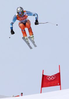 Mayer beats Miller, Svindal in Olympic downhill - Norway's Aksel Lund Svindal jumps during the men's downhill at the Sochi 2014 Winter Olympics, Sunday, Feb. 9, 2014, in Krasnaya Polyana, Russia.(AP Photo/Luca Bruno)