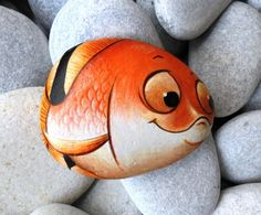 Hand painted stone Goldfish with big funny eyes ! A great handmade painted stone from me! Is painted on a smooth sea stone which i have