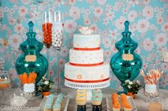 Orange and teal birthday party. The top tier, mom, is what I want the cake to look like! Click on the website to get a better picture that you can print out!