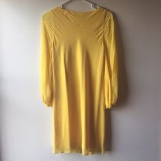 Alice + Olivia dress  EUC gorgeous Alice + Olivia long sleeve dress with jewel clasp on, worn only once and dry cleaned, gorgeous yellow color that will show off your tan and guarantee you'll stand out!  Alice + Olivia Dresses Long Sleeve