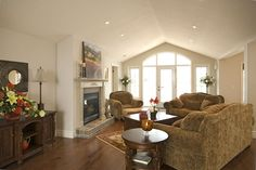 Vaulted ceiling in the great room...large transom windows, furniture placements, nice & bright!  www.qualityhomes.ca