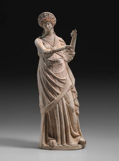 Statuette of standing draped Muse who holds her arms in a position of playing a kithara. Ancient Greek Clothing, Ancient Greek Art, Ancient Romans, Ancient Greece, Roman Sculpture, Stone Sculpture, Abstract Sculpture, Terracota, Greece Culture