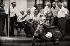Sicily, Italy.  You'll find several men getting together on the corners in all of Italy...while their wives are in the home cooking dinner.
