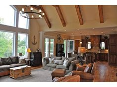 Check out the open layout and beautiful wall of windows in house plan DHSW077203 from Dream Home Source.