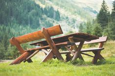 Wooden Picnic Seating Area in the Middle of Mountains Free Stock Photo Download   picjumbo