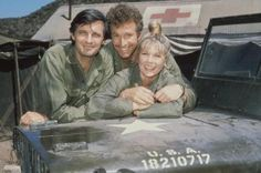 Wayne Rogers, as Captain Trapper John McIntyre, center, on the television series 'M.,' in Rogers died on Dec. 31 of complications from pneumonia at 82 in Los Angeles. Also pictured are actors Alan Alda and Loretta Swit. Most Popular Tv Shows, Favorite Tv Shows, Alan Alda Mash, Wayne Rogers, Old Tv Shows, Classic Tv, American Actors, American History, Artists