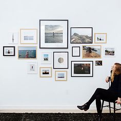 Hanging bigger items in the middle of your gallery wall and filling the outer edges with smaller frames makes for a starburst effect.
