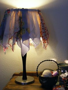 Vintage handkerchiefs displayed on lampshade