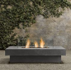 Laguna Concrete Propane Fire Table - Rectangle    Fire up a blaze instantly and provide hours of warmth. Our propane fire table pairs state-of-the-art fibercast concrete with clear glass panels that shelter the flames. The tabletop surface around the fire offers ample room for drinks and hors d'oeuvres. Decorative lava rocks fill the receptacle.