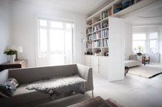 Interesting shelving/cupboard design for TV wall and above hallway door