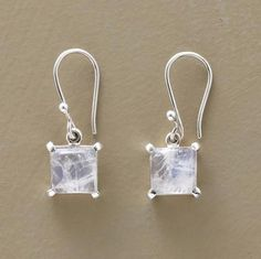 """Small moonstones, like miniature weather systems: ethereal and ever-changing. Sterling silver. Imported. 1""""L."""