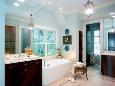 The blue-green wall color of this master bathroom soothes and refreshes. (Photo: Photo: John O'Hagan; Stylist: Lydia DeGaris-Pursell, Jan Gautro, and Kiersten Moore)