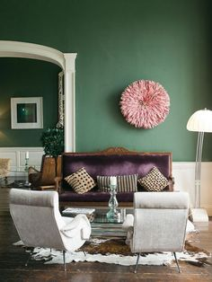 A great green accent wall provides the perfect backdrop for the luxe tones and textures in this space.