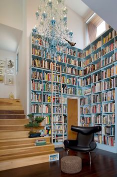 Storage space is the key to a functional and well-designed library. It is a good idea to make the most of vertical space and save precious floor space. [Home Library Ideas, Dedicated Library Ideas, Built In Bookshelf, Leather Armchair, Hardwood Floors, Library Room Ideas, Library Room Ladder, Large Chandelier]