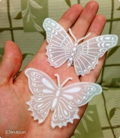 By Elenasun. Vellum butterflies. Not sure how she made them, but they're pretty!