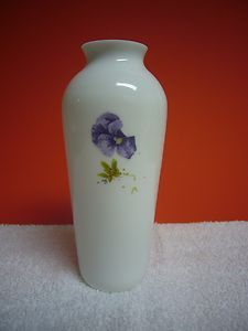 "Beautiful decorative collectible Marjolein Bastin white glass vase with purple floral design.  6"" tall and 2 1/2"" in diameter at its widest point.  Mint condition, this vase will add beauty to any setting!"