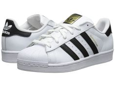 black adn white adidas shoes with a little bit of gold