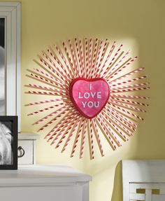"""Make a fun pink and red heart wreath that says """"I love you!"""" This is a fun and easy valentine craft, and you get to use paper straws!"""