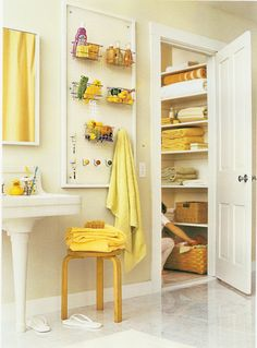 pegboard in the bathroom- good idea if no linen closet, or small storage area within bathroom