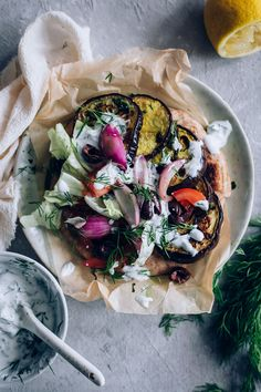 These Grilled Eggplant Gyros with Vegan Tzatziki are super flavorful and simple enough for a weeknight dinner. The post Grilled Eggplant Gyros with Vegan Tzatziki appeared first on Tasty Recipes. Vegan Tzatziki, Tzatziki Recipes, Tzatziki Sauce, Vegan Vegetarian, Vegetarian Recipes, Cooking Recipes, Healthy Recipes, Grilled Eggplant, Vegan Dinners