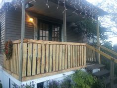 Porch railings my awesome husband made out of recycled pallets.