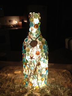 Wine bottle lights. Beautiful for inside or out. Drill hole at bottom of light, insert a bulb white string of lights, use glue gun to glue dollar store beads