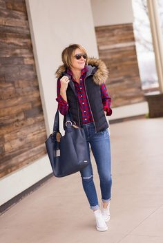 Layer a Gap puffer vest over your favorite button-down shirt for a laid-back winter afternoon. Here blogger Seersucker + Saddles pairs a navy Gap vest with a bright buffalo print check shirt.