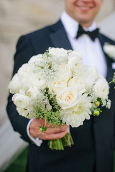There's nothing more romantic than a groom holding a bouquet: http://www.stylemepretty.com/wisconsin-weddings/kohler/2015/06/01/romantic-outdoor-wisconsin-wedding/ | Photography: Carly McCray - http://www.carlymccrayphotography.com/