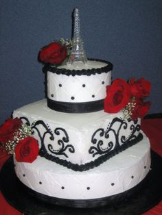 Divine cake featuring black, white, red roses and the Eiffel Tower.  Add edible skulls or tombstones to keep with the 'haunted' theme.