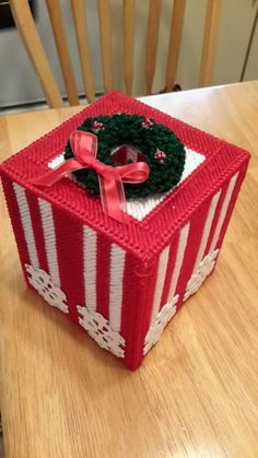 "Hand-made plastic canvas Christmas tissue box. 5"" x 5"" x 6"" measurement.  Great for decoration or as gift!"