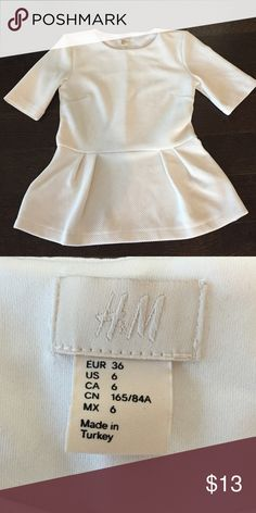Beautiful white peplum top! Perfect for summer! Size 6 H & M peplum top! Very comfortable material. Polyester & spandex H and M Tops