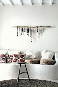 Love that simple wood wall hanging. Would be great for hanging scarves and necklaces on!