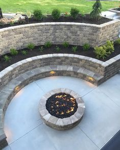I have summer on the mind, and I loved this walk out basement fire pit! Look at that amazing built in bench. I think someday we might…