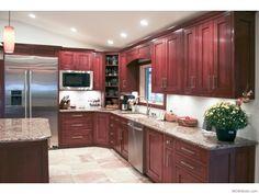 Cherry cabinets stainless steel light floors n light granite? Maybe dark granite if light floor