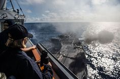 Sailors observe as the forward-deployed Arleigh Burke-class guided-missile destroyer USS McCampbell (DDG 85) fires its 5-inch gun during a live-fire training exercise.
