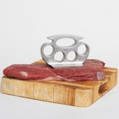 Pound it! A meat tenderizer that looks just like traditional brass knuckles. Tenderizer grid on base. Grooves make it easy to hold and pound the meat. Made of aluminum alloy. Measures 4.25 x 2.75 x 2-inches Please allow 3-7 days for delivery.