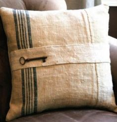 Pillow made from grain sacks and finished with a skeleton key