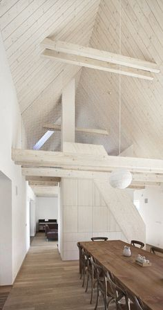 rustic wood table and floors contrast beautifully within a white room