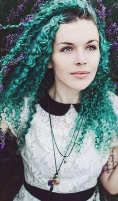 Green dyed curly hair color @arcticfoxhaircolor