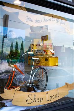 Don't Go Far … Shop Local Bicycle Propped Store Window
