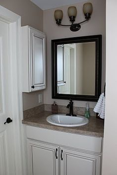 small bathroom- side storage - not in love but can take some ideas from the picture