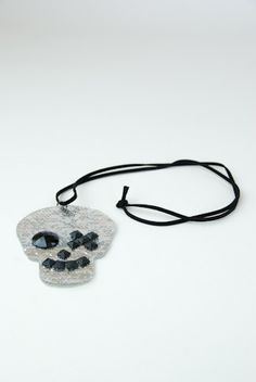Get skull-tastic with this awesome plastic and sequin necklace. There really is nothing to say about how awesome this piece is...so we'll stop & just let you make the right choice! $18.50