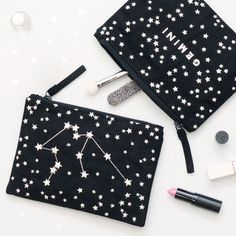 Black horoscope makeup bag