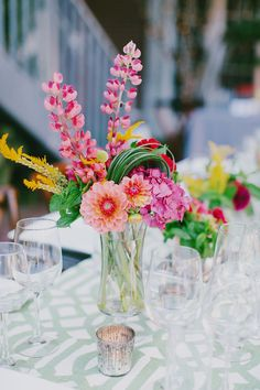 These colorful centerpieces are so full of fun! Photography by Milou Olin Photography / milouandolin.com/, Event Planning by Dream A Little Dream Events / dreamalittledreamevents.com, Floral Design by Natalie Bowen Designs / nataliebowendesigns.com